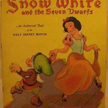 Grimm fairy tale. Pursued by a jealous queen, Snow White hides with seven Dwarfs.